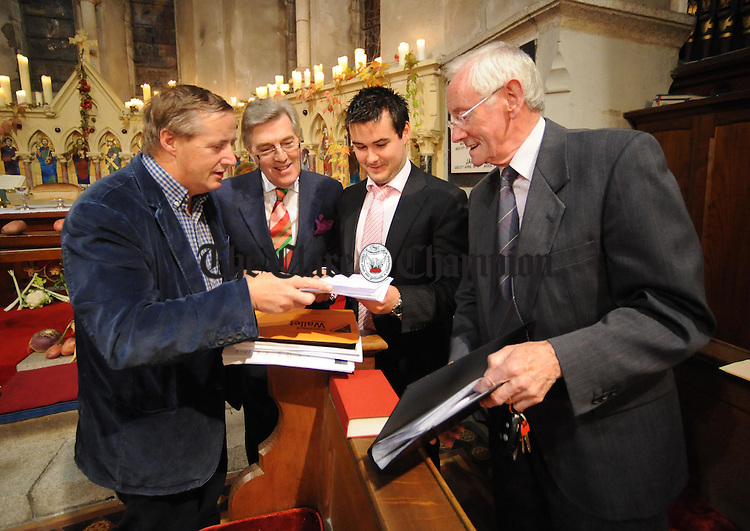 Michael Henessey,Nigel Bridge, Leon Walsh and Michael Collins from the Cathedral Choir making last minute preparations for the service taking place at St Columba's Church in Ennis during this year's Harvest Festival. Photograph by Declan Monaghan