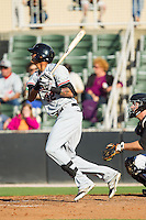 Jairo Beras (32) of the Hickory Crawdads follows through on his swing against the Kannapolis Intimidators at CMC-Northeast Stadium on May 18, 2014 in Kannapolis, North Carolina.  The Intimidators defeated the Crawdads 6-5 in 10 innings.  (Brian Westerholt/Four Seam Images)