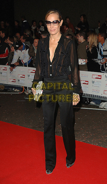 TARA PALMER TOMPKINSON .Attending The Daily Mirror's Pride Of Britain Awards,.London Television Studios, London, England,.November 7th 2006..full length TPT sunglasses black shirt blouse trousers silver clutch bag.Ref: BEL.www.capitalpictures.com.sales@capitalpictures.com.©Tom Belcher/Capital Pictures.