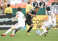 Andy Najar #14 of D.C. United tries to move past Will Johnson #8 and Tony Beltran #2 of Real Salt Lake during an MLS match at RFK Stadium, on June 5 2010 in Washington DC. The game ended in a 0-0 tie.