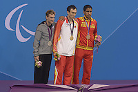 01.09.2012 London, England Bradley Snyder of United States silver medal (L) Bozun Yang of China gold medal © Enhamed Enhamed of Spain Bronze medal ® in the  men's  50m Freestyle final during Day 3 of the London Paralympics Games Olympic Park Aquatic Arena  .