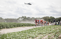 Peloton over  the Plugstreets Gravel Sections. <br /> <br /> <br /> 1st Great War Remembrance Race 2018 (UCI Europe Tour Cat. 1.1) <br /> Nieuwpoort &gt; Ieper (BE) 192.7 km