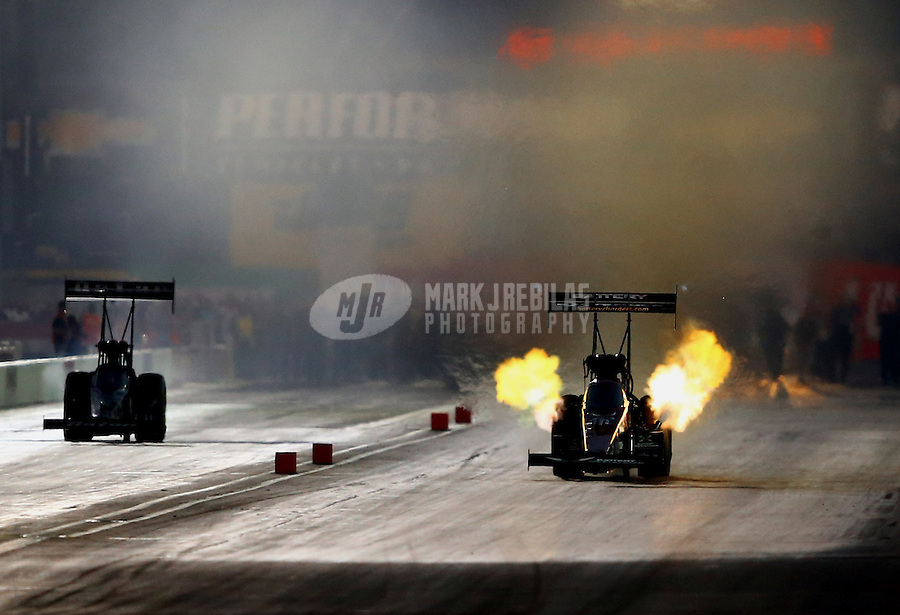 Aug. 30, 2013; Clermont, IN, USA: NHRA top fuel dragster driver Spencer Massey (right) during qualifying for the US Nationals at Lucas Oil Raceway. Mandatory Credit: Mark J. Rebilas-