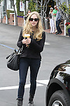 .March 28th 2012...Amanda Seyfried shopping at Fred Segal with some friends  off Melrose ave in west Hollywood. An asian fan took a picture with Amanda . black leather purse handbag old army boots holding coffee ..AbilityFilms@yahoo.com.805-427-3519.www.AbilityFilms.com