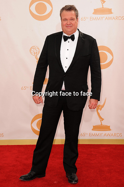 Eric Stonestreet arrives at the 65th Primetime Emmy Awards at Nokia Theatre on Sunday Sept. 22, 2013, in Los Angeles.<br />