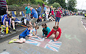 Grand Depart - Tour de France 2014<br /> Yorkshire England.<br /> Leaders go through famous town of Ilkley with Moors in distance.<br /> <br /> Kids chalking a union jack  - Cavendish fans<br /> Pic by Gavin Rodgers/Pixel 8000 Ltd
