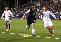 BOCA RATON, FL - DECEMBER 15, 2012: Abby Wambach (14) of the USA WNT pushes off on Li Jiayue (4) of China WNT during an international friendly match at FAU Stadium, in Boca Raton, Florida, on Saturday, December 15, 2012. USA won 4-1.