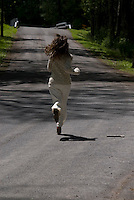 Woman running on country road