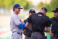 Midland RockHounds manager Scott Steinmann (33) chats with the officiating crew on May 6, 2019, at Arvest Ballpark in Springdale, Arkansas. (Jason Ivester/Four Seam Images)