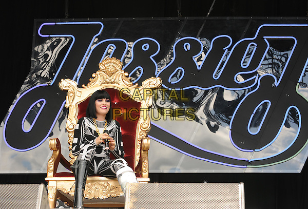 Jessie J (Jessica Ellen Cornish).Jessie J performs on Day Three of the Glastonbury Festival at Worthy Farm, Pilton, England. .June 25th, 2011.stage concert live gig performance music full length black white catsuit jumpsuit sitting throne chair cast broken leg injury   .CAP/WIZ.© Wizard/Capital Pictures.