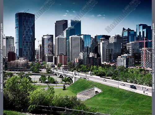 Calgary city downtown beautiful skyline with Centre Street Bridge over Bow river artistic scenery with dramatic colors. Calgary, Alberta, Canada 2017.