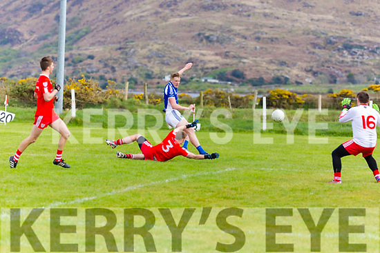 Pat Spillane for Templenoe goes it alone and get the better of Waterville's Daniel O'Dwyer before drilling this one past Waterville's Keeper Patrick O'Dwyer.  Waterville 0-9 Templenoe 2-9.