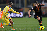 Calcio, semifinale di andata di Coppa Italia: Roma vs Napoli. Roma, stadio Olimpico, 5 febbraio 2014.<br /> AS Roma forward Adem Ljajic, of Serbia, right, is challenged by Napoli midfielder Jorginho, of Brazil, during the Italian Cup first leg semifinal football match between AS Roma and Napoli at Rome's Olympic stadium, 5 FeBruary 2014.<br /> UPDATE IMAGES PRESS/Riccardo De Luca