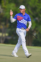 Yung-Hua LIU (TPE) acknowledges the applause after sinking his putt on 18 during Rd 1 of the Asia-Pacific Amateur Championship, Sentosa Golf Club, Singapore. 10/4/2018.<br /> Picture: Golffile | Ken Murray<br /> <br /> <br /> All photo usage must carry mandatory copyright credit (&copy; Golffile | Ken Murray)