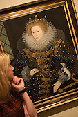 "A museum worker stands in front of the paiting ""Queen Elizabeth I, The 'Ermine' Portrait"" attributed to Nicholas Hilliard, 1585. Press preview of the exhibition ""Elizabeth I & Her People"" at the National Portrait Gallery which explores the remarkable reign of Elizabeth I through the lives and portraiture of her subjects. Exhibition runs from 10 October 2013 to 5 January 2014."
