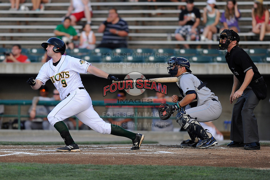 First baseman Trenton Moses (9) of the Lynchburg Hillcats bats in a game against the Wilmington Blue Rocks on Tuesday, June 25, 2013, at Calvin Falwell Field in Lynchburg, Virginia. The Wilmington catcher is Kenny Swab and the umpire is Jimmy Hollingsworth. Lynchburg won, 3-2. (Tom Priddy/Four Seam Images)