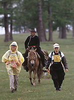 26 JUN 2002 - KHOVSGOL NATIONAL PARK, MONGOLIA - Kathleen Ward and Beth Haynes receive a Mongolian escort to the finish line of the Mongolia Sunrise to Sunset race. (PHOTO (C) NIGEL FARROW)