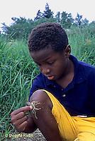 WF25-005z  Crayfish - boy looking at crayfish found in stream