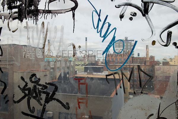 View of the Vinegar Hill neighborhood of Brooklyn from a Graffiti Covered Window in the adjoining neighborhood of DUMBO, Brooklyn, New York City, New York State, USA