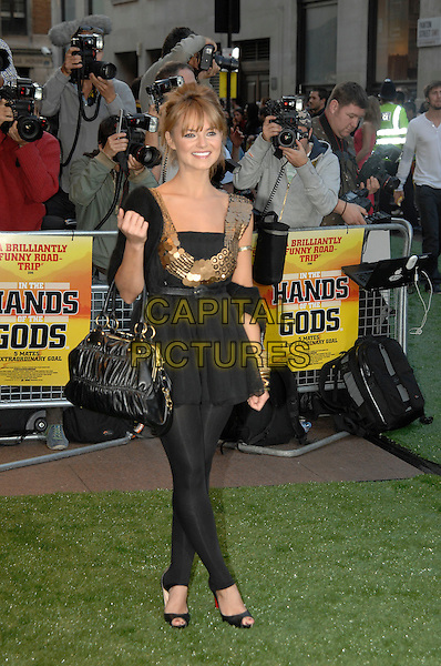 "KARA TOINTON.""In the Hands of the Gods"" World Charity Film Premiere.Odeon West End Cinema, Leicester Square, London, England, 10th September 2007 .full length black and gold mini dress top leggings ski pants Chrisitan Louboutin shoes bag.CAP/PL.©Phil Loftus/Capital Pictures"