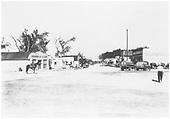 Espanola Main Street scene.  Morris &amp; Clark and Espanola Mercantile are identifiable businesses.  Two Conoco delivery trucks are in the scene.<br /> Espanola, NM  Taken by Schentzel, - circa 1938