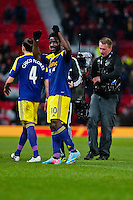 Sunday 05 January 2014<br /> Pictured:Swans Players celebrate after the game<br /> Re: Manchester Utd FC v Swansea City FA cup third round match at Old Trafford, Manchester