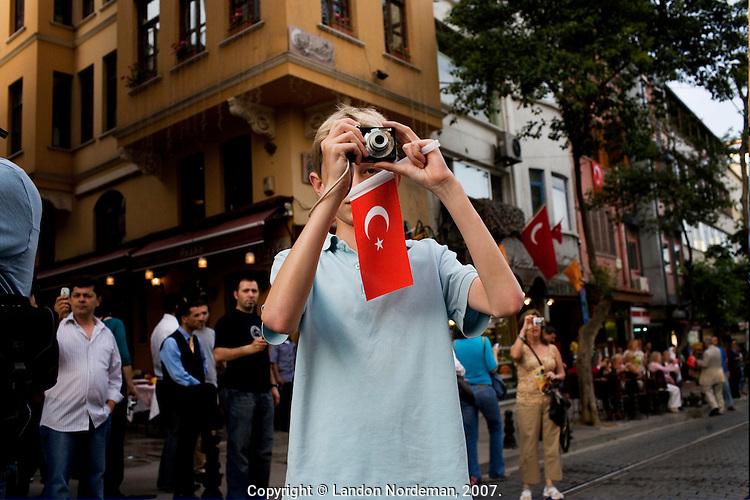 ISTANBUL - MAY 29, 2007:   A young boy photographs a National Parade inIstanbul, Turkey. Photo by Landon Nordeman.