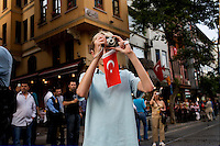 ISTANBUL - MAY 29, 2007:   A young boy photographs a National Parade inIstanbul, Turkey. Photo by Landon Nordeman.
