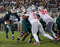 Michigan State Spartans quarterback Connor Cook (18) carries the ball against Ohio State Buckeyes defense during the 2nd quarter at Spartan Stadium in East Lansing, Michigan on November 8, 2014.  (Dispatch photo by Kyle Robertson)