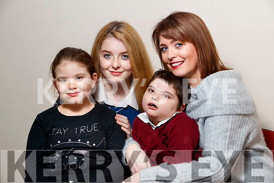 Liz Forde, Ardfert, who won the Carer of the Year Award pictured with her children, Gwen, Ellie and Killian and Liz.