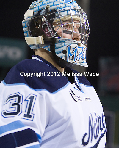 Josh Seeley (Maine - 31) - The University of Maine Black Bears defeated the University of New Hampshire Wildcats 5-4 in overtime on Saturday, January 7, 2012, at Fenway Park in Boston, Massachusetts.