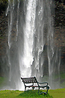 A wistful curtain of water and an inviting bench. Seljalandsfoss is found in Southern Iceland.