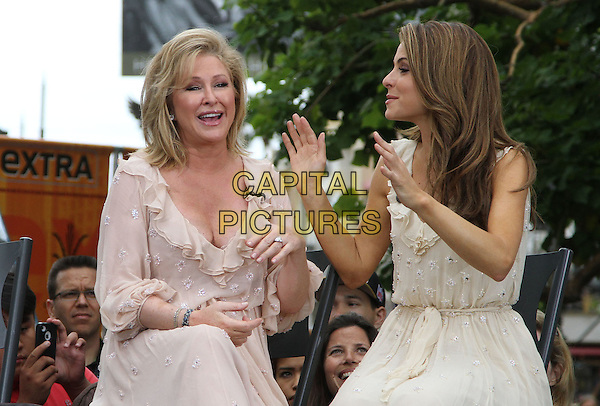 "Kathy Hilton, Maria Menounos.Gabriel Mann And Kathy And Paris Hilton Fashion Show On ""Extra"" Held at The Grove, West Hollywood, California, USA..May 2nd, 2012.half length beige dress hands sitting profile pink.CAP/ADM/KB.©Kevan Brooks/AdMedia/Capital Pictures."