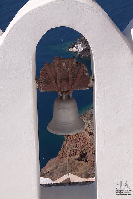 Greek Church Bell Tower with the Santorini Coastline