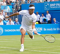 Feliciano Lopez (ESP) against Rafael Nadal (ESP) in the quarter final of the men's singles. Feliciano Lopez beat Rafael Nadal 7-6 6-4..Tennis - ATP World Tour - AEGON Championships - Queen's Club - London - Day 5 - Fri 11 Jun 2010..© AMN Images - Level 1, Barry House, 20-22 Worple Road, London, SW19 4DH.Tel - +44 (0) 208 947 0100.email - mfrey@advantagemedianet.com. www.photoshelter.com/c/amnimages.