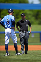 Charlotte Stone Crabs manager Michael Johns (9) questions a call with field umpire Grant Conrad during a game against the Palm Beach Cardinals on April 10, 2016 at Charlotte Sports Park in Port Charlotte, Florida.  Palm Beach defeated Charlotte 4-1.  (Mike Janes/Four Seam Images)
