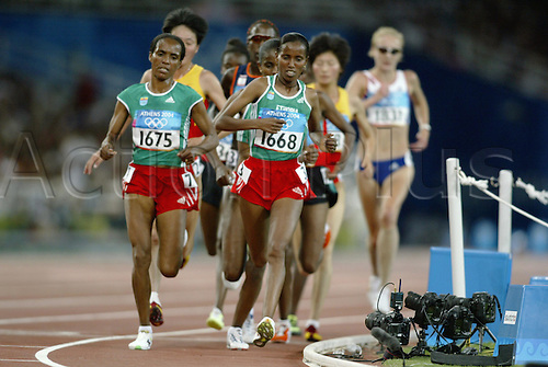 27 August 2004: Ethiopian runners DERARTU TULU (left) and WERKNESH KIDANE (ETH) lead during the Women's 10,000m Final at the Olympic Stadium, Athens 2004 Olympic Games, Greece. Photo: Glyn Kirk/Action Plus....040827 olympics athletics track event running.
