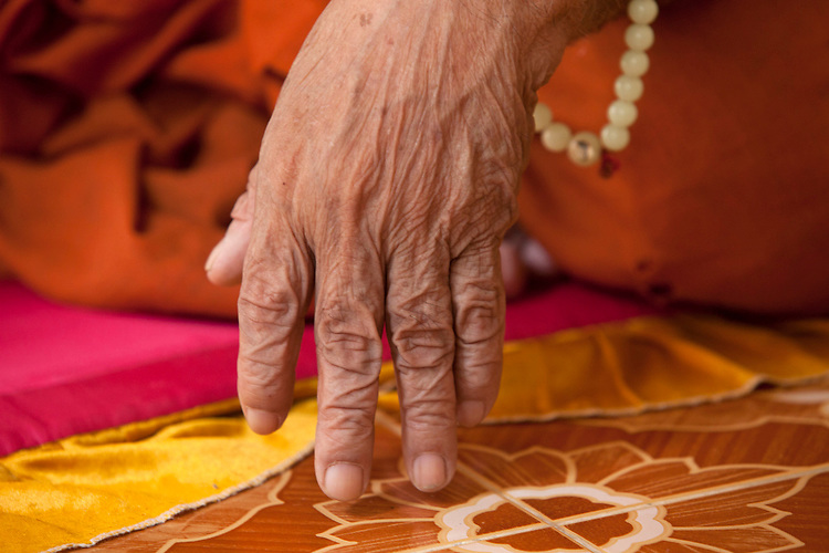 Details of the hand of an 80-year-old blind monk lives in a temple in a village near Battambang, Cambodia. <br /> <br /> Photos &copy; Dennis Drenner 2013.