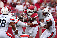 NWA Democrat-Gazette/BEN GOFF @NWABENGOFF<br /> Alex Collins, Arkansas running back, breaks the tackle of Kris Frost, Auburn linebacker, in the first quarter on Saturday Oct. 24, 2014 during the game in Razorback Stadium in Fayetteville.