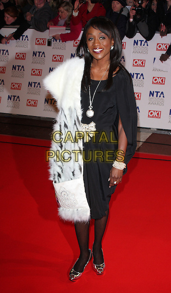 DIANE PARISH.The 15th National Television Awards held at the O2 Arena, London, England. .January 20th, 2010 .NTA NTAs full length black dress white fur gold peep toe shoes shiny necklace pearl bracelet .CAP/ROS.©Steve Ross/Capital Pictures.
