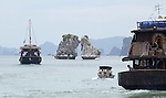 Halong-Vietnam, Ha Long - Viet Nam - 22 July 2005---Boats with tourists approaching the Fighting Cooks (Hon Ga Choi), a landmark at Halong Bay, a UNESCO World Natural Heritage Site---culture, tourism, landscape, nature, traffic---Photo: Horst Wagner/eup-images