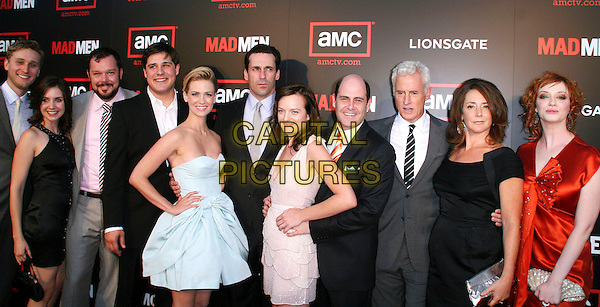 "MAD MEN CAST.""Mad Men Season 2"" Premiere held at the Egyptian Theatre, Hollywood, California, USA..July 21st, 2008.half length black grey gray suit pink dress red orange satin silk hand on hip cast.CAP/ADM/FS.©Faye Sadou/AdMedia/Capital Pictures."