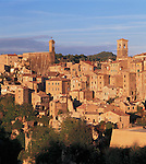 Tuscany, Italy<br /> Bell towers rise above the terraced buildings and tiled roofs of Sorano, a hill town in southern tuscany