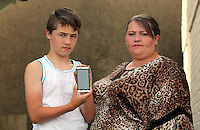 FAO NIGEL BARKLIE, DAILY MAIL PICTURE DESK<br /> Pictured: Lisa Howells with son Mikey at their home in Carmarthen. Thursday 14 July 2016<br /> Re: Lisa Howells from Carmarthen, west Wales is angry after a TT Sims mobile phone she bought for her son Mikey from Tesco seems to have infections that cannot be removed, making the phone access porn sites even after factory re-sets have been done.