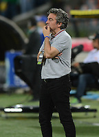 MEDELLÍN -COLOMBIA-10-08-2014. Juan Manuel Lillo técnico de Millonarios gesticula durante el partido contra Atlético Nacional por la fecha 4 de la Liga Postobón II 2014 jugado en el estadio Atanasio Girardot de la ciudad de Medellín./ Millonarios coach Juan Manuel Lillo gestures during the match against Atletico Nacional for the 4th date of the Postobon League II 2014 at Atanasio Girardot stadium in Medellin city. Photo: VizzorImage/Luis Ríos/STR