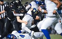 NWA Democrat-Gazette/CHARLIE KAIJO Bentonville defenders bring down North Little Rock running back Aaron Sims (32) Friday, November 29, 2019 during the Class 7A semifinal at Bentonville High School in Bentonville.