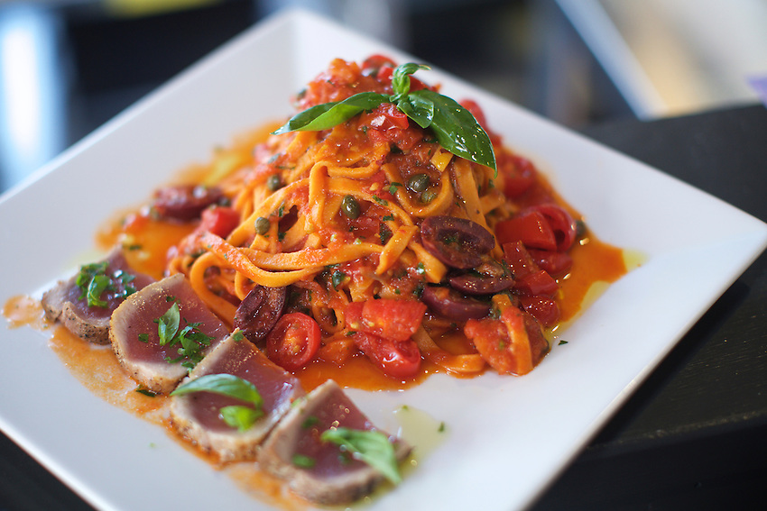 Jersey City, NJ - April 27, 2016: Linguine di Pomodoro al Tonno e Puttanesca, Seared tuna served raw in the middle with tomato linguine in traditional Neopolitan sauce of olives, capers, anchovies &amp; fresh tomato at Pasta dal Cuore, a pasta-focused Italian restaurant in Jersey City.<br /> <br /> CREDIT: Clay Williams for Gothamist<br /> <br /> &copy; Clay Williams / claywilliamsphoto.com