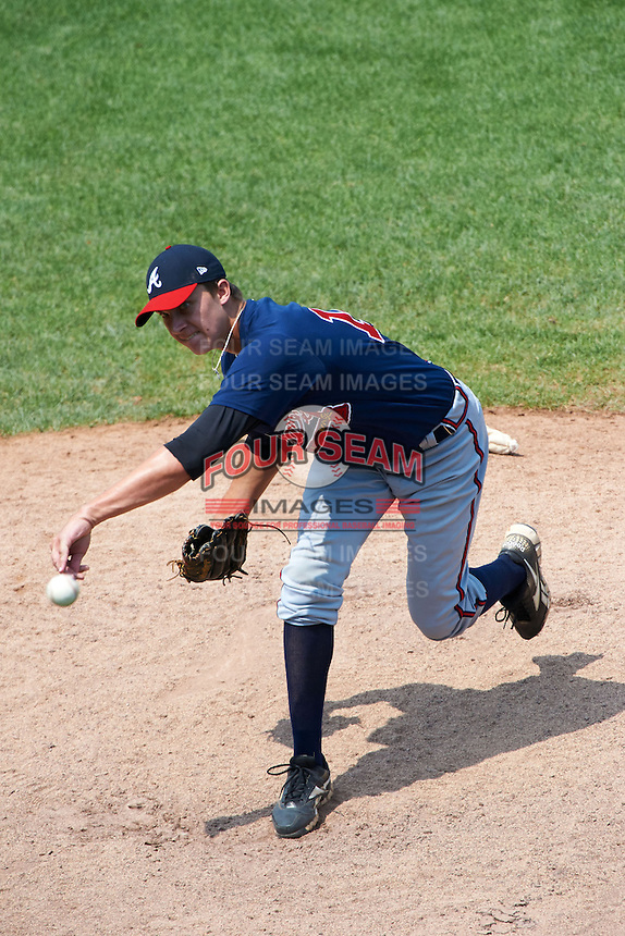 Carson Sands #12 of North Florida Christian School in Tallahassee, Florida playing for the Atlanta Braves scout team during the East Coast Pro Showcase at Alliance Bank Stadium on August 4, 2012 in Syracuse, New York.  (Mike Janes/Four Seam Images)