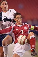 "Denmark's Katrine Pedersen looks to control the ball in front of USA's Abby Wambach. The US Women's National Team tied the Denmark Women's National Team 1 to 1 during game 8 of the 10 game the ""Fan Celebration Tour"" at Giant's Stadium, East Rutherford, NJ, on Wednesday, November 3, 2004.."