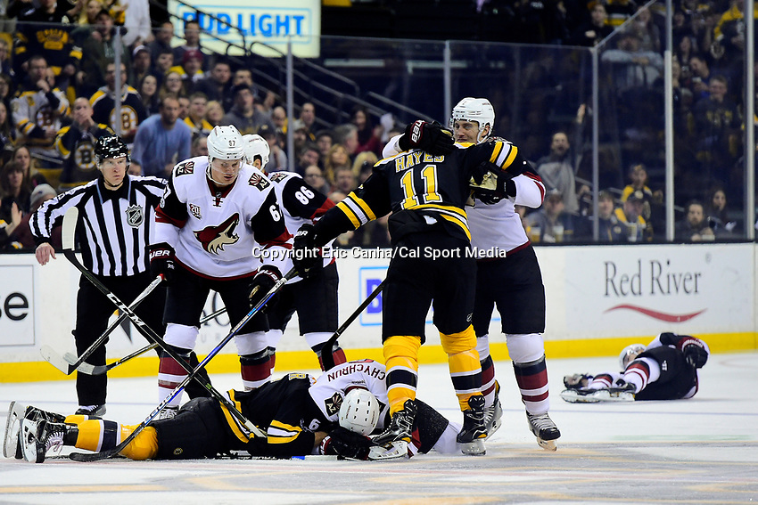 Tuesday, February 28, 2017: Boston Bruins defenseman Colin Miller (6) and Arizona Coyotes defenseman Jakob Chychrun (6) wrestle on the ice as Arizona Coyotes center Alexander Burmistrov (91) remains down in the background during the National Hockey League game between the Arizona Coyotes and the Boston Bruins held at TD Garden. Arizona Coyotes center Alexander Burmistrov (91) was taken off the ice by stretcher, Miller received but a charging penalty as well as a game misconduct for the play that resulted Burmistrov's injury. Boston defeats Arizona 4-1. Eric Canha/CSM